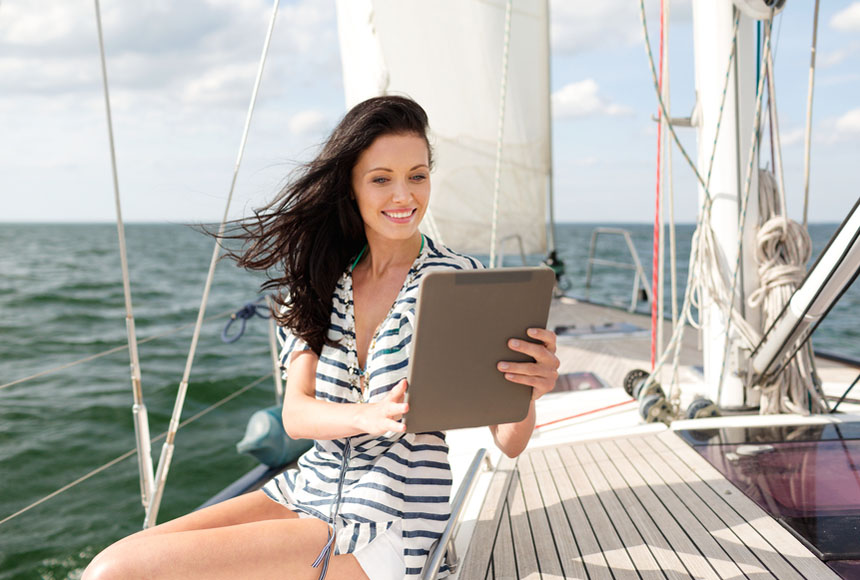 Lady using a tablet during vacation