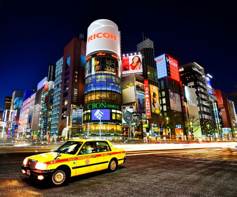 Taxi and buildings in Tokyo, Japan